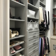 Keep your bedroom closet organized with our custom organizers and white melamine.