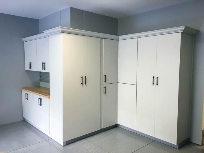 White melamine storage cabinets.